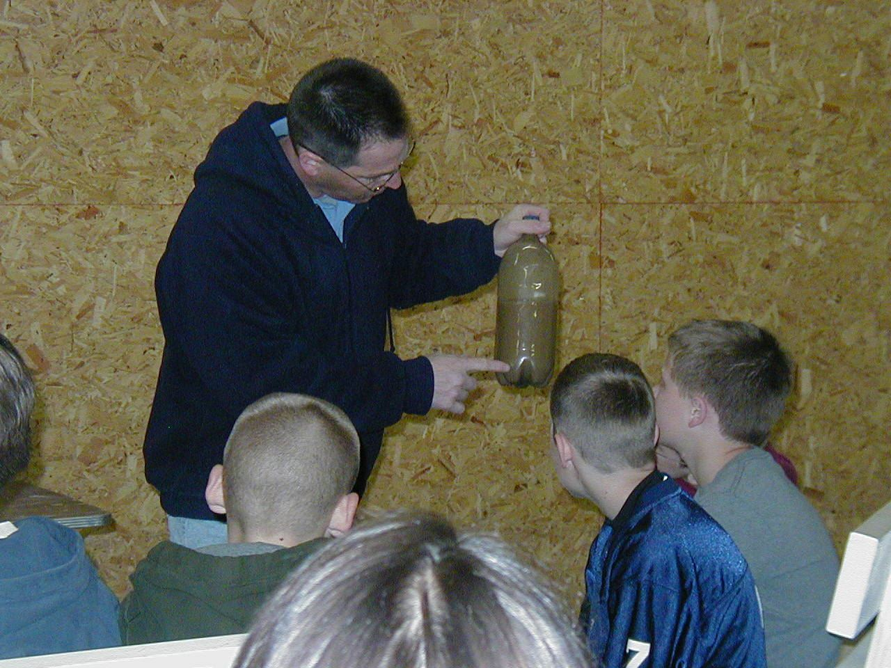Students learn about soil and water conservation from conservation staff